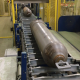 Gas cylinder on the processing conveyor line