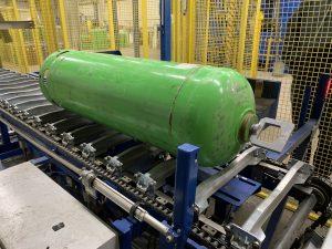 Gas cylinder on processing conveyor line